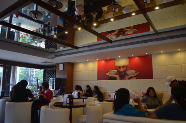 Patrons relaxing at a Cafe Coffee Day outlet in Bangalore (Photo: Simon Roughneen)