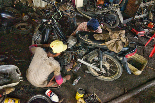 Mechanics at work at Cheang Vannak's garage in Siem Reap province (Photo: Simon Roughneen)