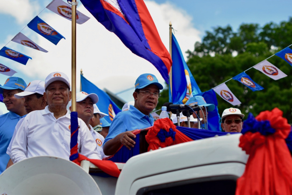 Cambodian Prime Minister Hun Sen speaking to supporters of the ruling Cambodian People's Party while en route around capital Phnom Penh during the final commune election campaign events held on June 2 (Photo: Simon Roughneen)