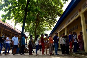 Voters lining up to enter a polling station inside a school in the south of the Cambodian capital Phnom Penh on June 4 (Photo: Simon Roughneen)