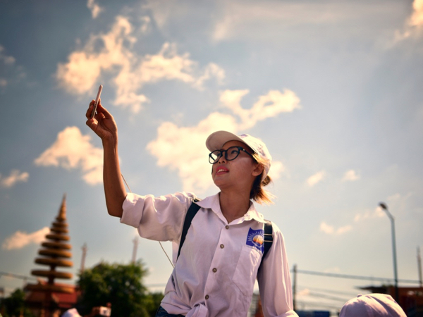 CNRP supporter taking selfie during opposition party rally in Phnom Penh on June 2 (Photo: Simon Roughneen)