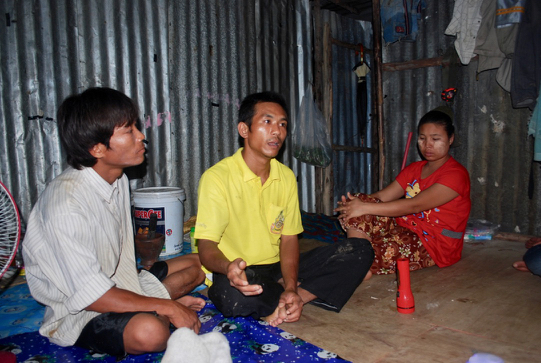 Myanmar migrants discussing their struggles with people smugglers and traffickers on the outskirts of the Thai capital Bangkok (Photo: Simon Roughneen)