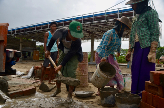 Construction workers mixing concrete in Myanmar's Irrawaddy Delta (Photo: Simon Roughneen)