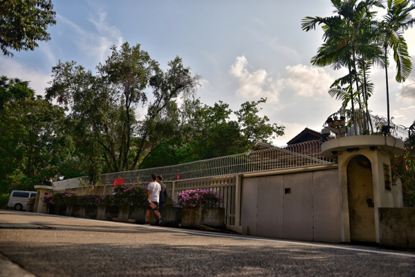 People walk past 38 Oxley Road in Singapore (Simon Roughneen)