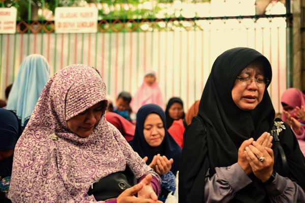 Demonstrators crying outside the Myanmar embassy in Jakarta as they listen to appeals by protest leaders that the Indonesian government put more pressure on its Myanmar counterpart Sept 4 2017 (Simon Roughneen)