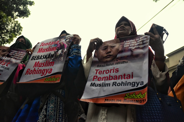 Protestors outside the Myanmar embassy in Jakarta on Sept 4 2017, carrying placards denouncing the Myanmar Buddhist monk Wirathu, who has long been accused of fanning anti-Muslim prejudice in Myanmar (Simon Roughneen)