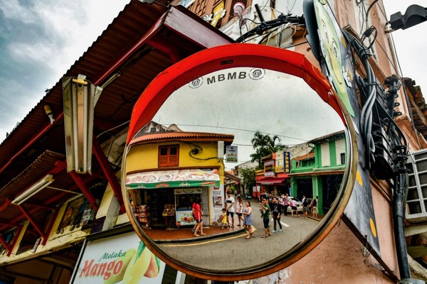 Tourists taking in some of Melaka's backstreets on a weekend morning (Simon Roughneen)