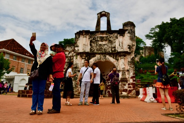 Visitors pose for the obligatory selfie at A Famosa, the remnants of a 16th century Portuguese fortress (Simon Roughneen)