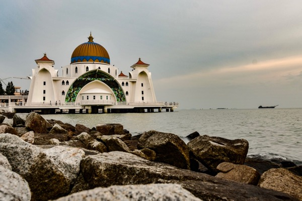 The Melaka Straits Mosque is built on an artificial island and is a popular location for evening prayers and viewing the straits at sunset (Simon Roughneen)