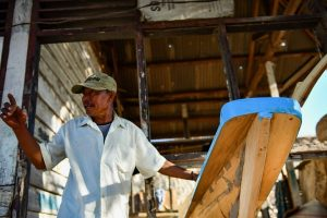 Zubaidi working a new fishing boat in Kwangko. Photo: Simon Roughneen