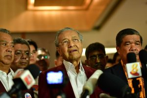 Muhyiddin Yassin pictured to the right of Mahathir Mohamad on the night of May 9 2018, when their Pakatan Harapan/Alliance of Hope won national elections (Simon Roughneen)