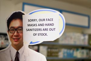 Sign on a doorway at Kuala Lumpur pharmacy (Simon Roughneen)
