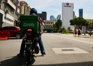 Food delivery motorcycles are about the most commonly-seen traffic in Kuala Lumpur during the virus lockdown (Simon Roughneen)
