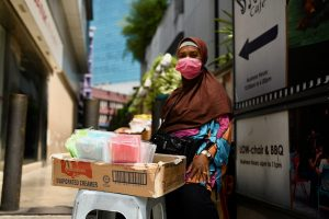 Woman selling sanitary masks in Kuala Lumpur on March 17 2020, the day before Malaysia goes into a two-week lockdown (Simon Roughneen)