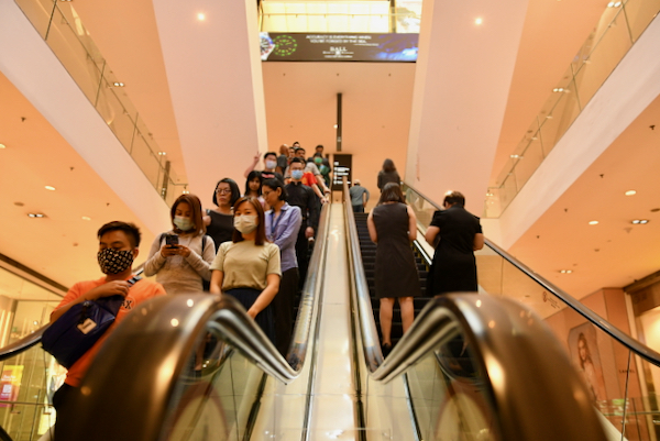 People wearing facemasks inside a Kuala Lumpur mall on March 17, the day before the start of an anti-virus lockdown (Simon Roughneen)
