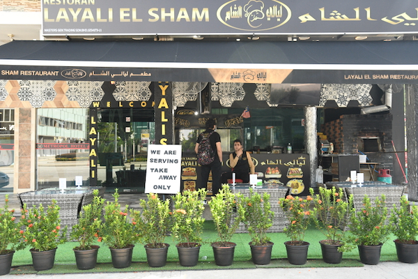 Restaurants in Malaysia, including this Lebanese diner in Kuala Lumpur, are limited to takeaway services or delivery during Malaysia' two-week coronavirus part-lockdown which started on Wednesday (Simon Roughneen)