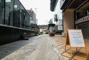Beggars on otherwise near-empty streets during lockdown in Kuala Lumpur (Simon Roughneen)
