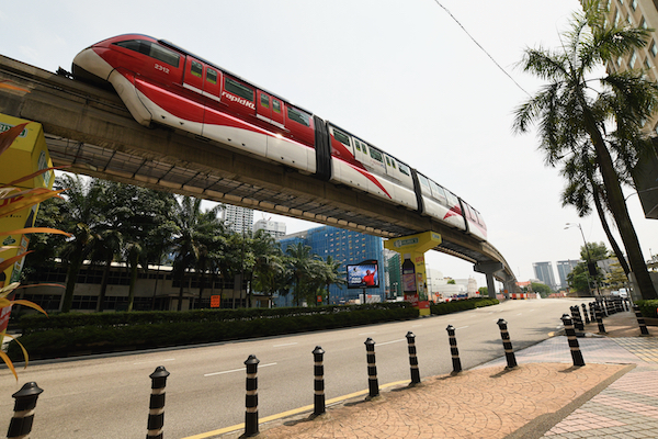 A light rail train on the move pver a Kuala Lumpur street left empty by Malaysia's lockdown (Simon Roughneen)