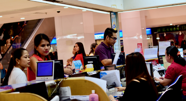 Burmese migrant workers in Singapore's Peninsular Plaza, a popular meeting point for workers from Myanmar who live in the city-state (Simon Roughneen)