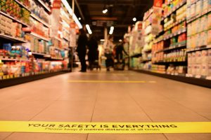 Social distancing markers on floor of Dublin supermarket (Simon Roughneen)