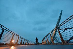 The Peace Bridge spanning the River Foyle as it runs through Derry (Simon Roughneen)