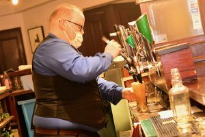 Pouring pints in an Irish hotel restaurant on June 29 2020, the day some pubs and restaurants were perrmitted to reopen