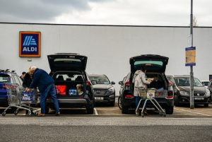 Shoppers in the west of Ireland loading their cars outside a supermarket. one of the handful of retailers allowed to stay open during Ireland's lockdowns (Simon Roughneen)