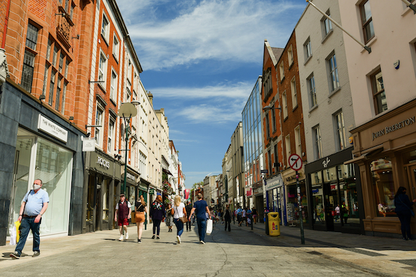 Pedestrians seen on Grafton St., one of Dublin's main shopping avenues, in late May 2021. Ireland's economy was one of the few to grow last year (Simon Roughneen)