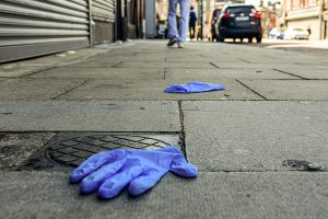 The coronavirus pandemic has led to pressure on medics and scientists over issues such as initial shortages of protective gloves, such as these seen discarded on a Dublin street, to demands about virus-related research ISimon Roughneen)