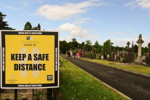 Pandemic-related 'social distancing' message, outdoors, in Dublin's Glasnevin Cemetery (Simon Roughneen)