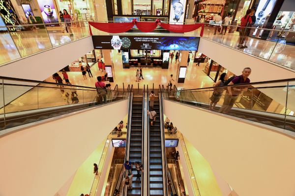 Standing on an escalator, as people are seen doing in this mall in Malaysia, rather than climbing stairs ,is likely to reduce overall fitness (Simon Roughneen)